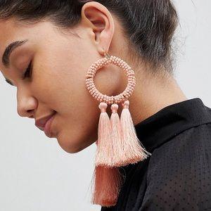 Pink beaded tassel statement earrings